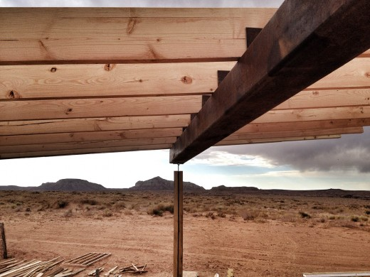 finished patio roof structure: column, flitch plate, beam, and joists