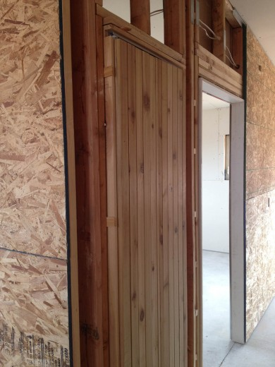 hall closet door will blend seamlessly with surrounding cedar cladding when finished