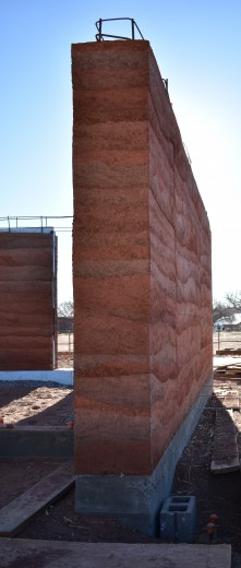 The final rammed earth wall at its finest.