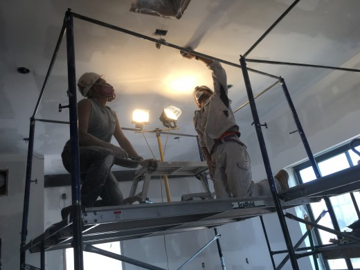 Jared and Atsushi sanding the ceiling, prepping for primer.